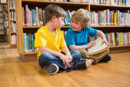 Pupils reading books at elementary school